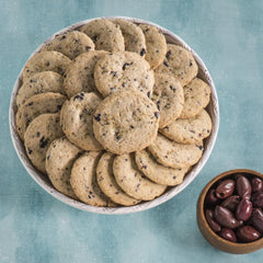 Kalamata Olive Cookies in bowl with olives