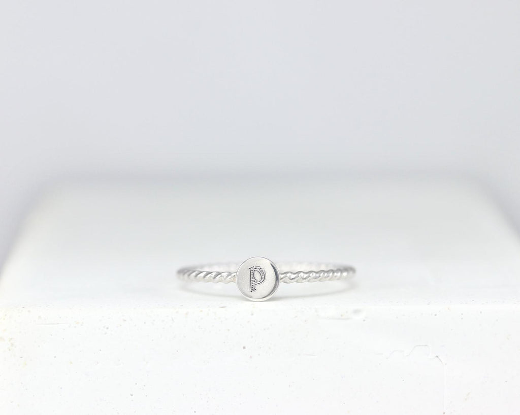 Twisted Initial Ring
