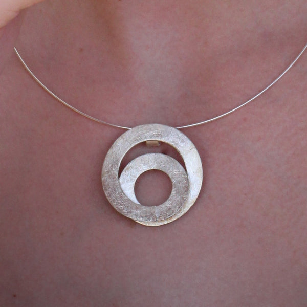 Unique spiral shape silver pendant