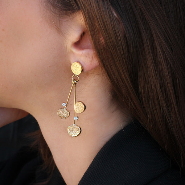 Sabres shape hanging gold & diamonds earrings