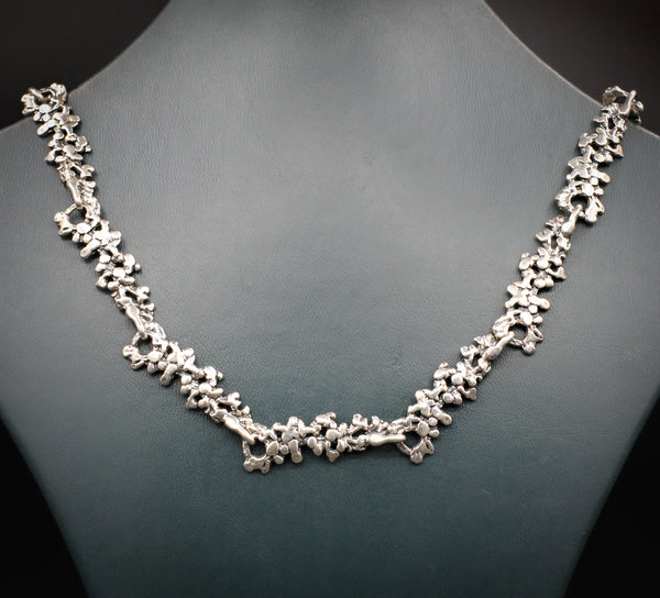 Abstract silver necklace