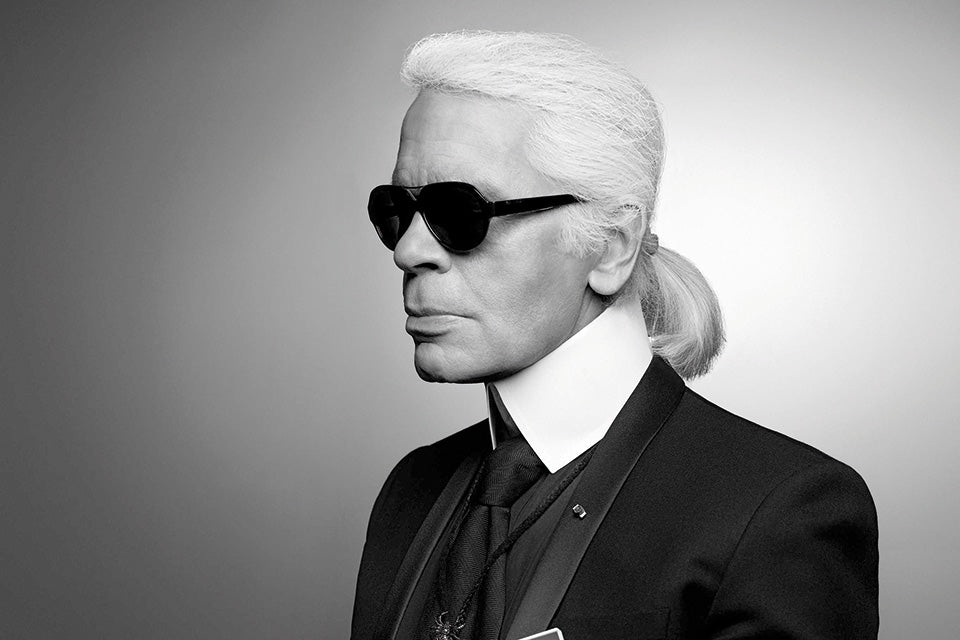 Karl lagerfeld portrait shooting in black tie and iconic white shirt