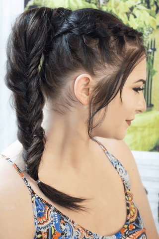 Girl wearing fish tail braid ponytail extension by Queen C Hair Extensions