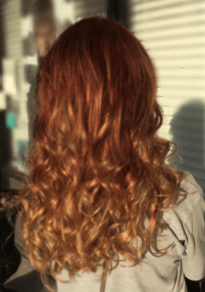 Girl wearing Copper Red Dirty Blonde Balayage Hair Extensions from Queen C Hair