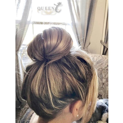 woman wearing a highlight ponytail extension in a bun by Queen C Hair Extensions