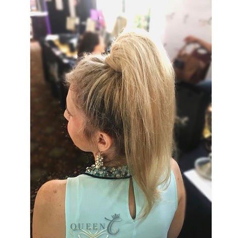 Woman wearing mint green shirt with a high ponytail human hair ponytail extension by Queen C Hair