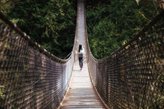woman walks on bridge