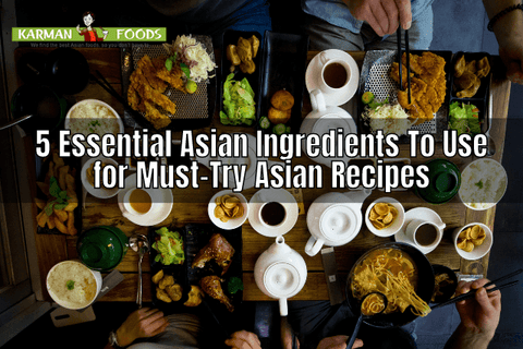 4 people sitting around a table laden with various Asian food