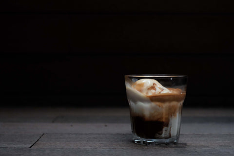 A clear glass filled with Mocha Affogato