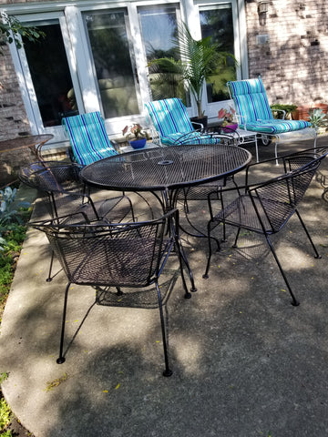 Wrought iron black table with 4 matching chairs