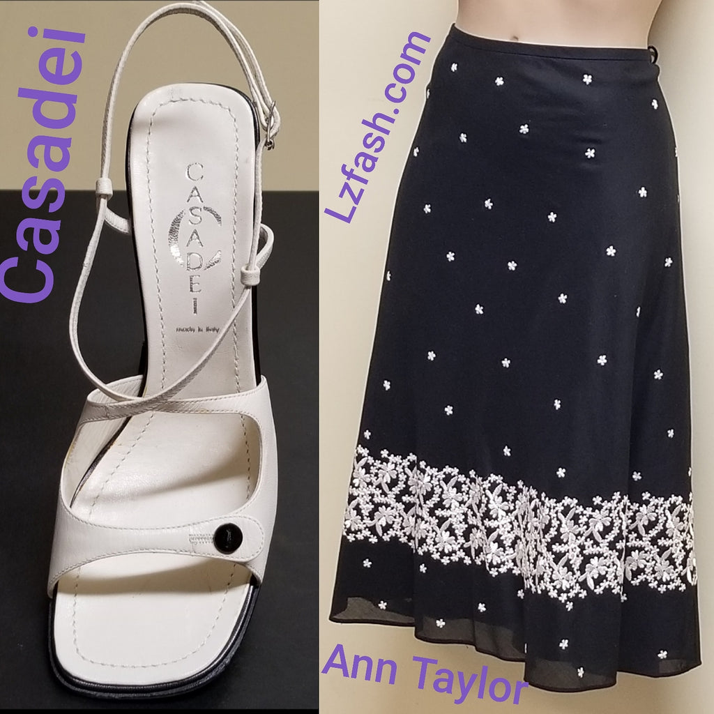 Ann Taylor black skirt with white embroidered patterns, size 4