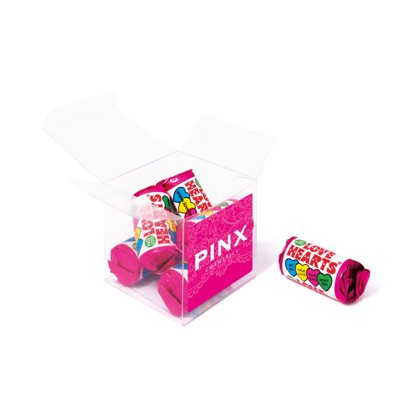 These promotional love hearts are branded with a digitally printed flat label on the clear cube container.