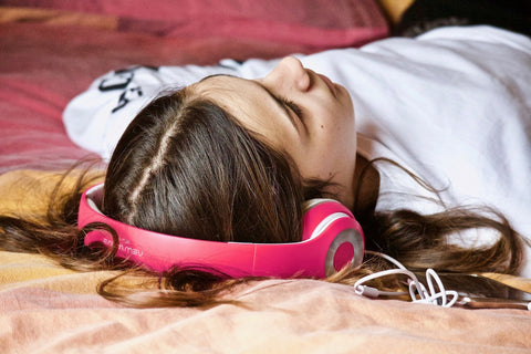 Woman wearing headphones listening