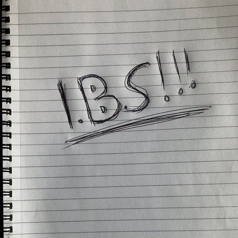 Letter IBS written on note pad with exclamation marks