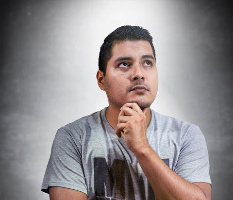 Man looking pensive away from camera