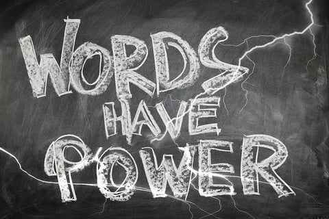 Blackboard with the words - Words have Power written in chalk.
