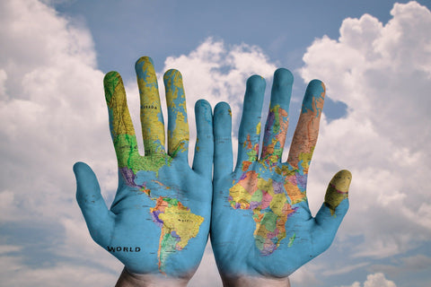 Photo of painted earth on open hands
