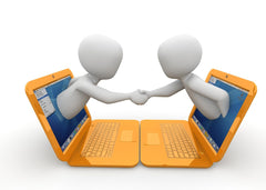 Image of two laptops with people reaching out of the screen shaking hands