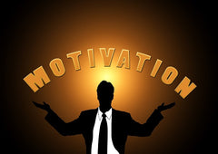Man with arms out stretched with the word motivation between