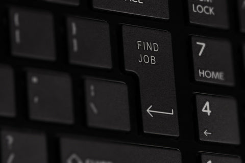 Keyboard with return key marked with find job