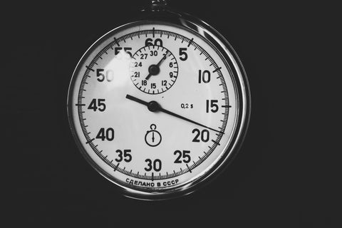 Photo of a stop-watch face on a black background