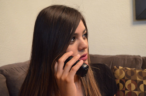 woman on phone looking concerned