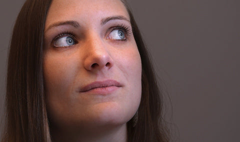 Photo of woman looking up and to the right with moist eyes