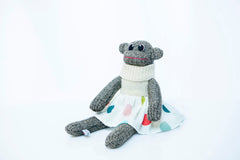 Red Rufus SockMonkey in a skirt and jumper, handmade in Ireland.