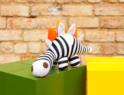 Darcy SocKDino, black and white striped dinosaur with orange spikes, felt eyes|Red Rufus