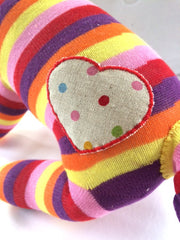 Fabric heart sewn on a Red Rufus SockDog | Red Rufus