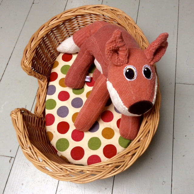 Ferfus SockFox made from a pair of socks, he's curled up in his basket | Red Rufus SockFox