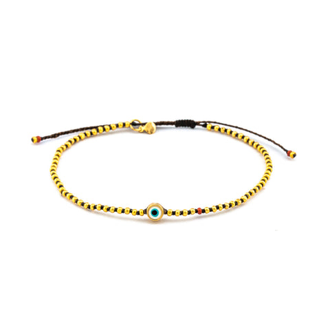 BEADED ADJUSTABLE BRACELET WITH ROUND ENAMEL EYE