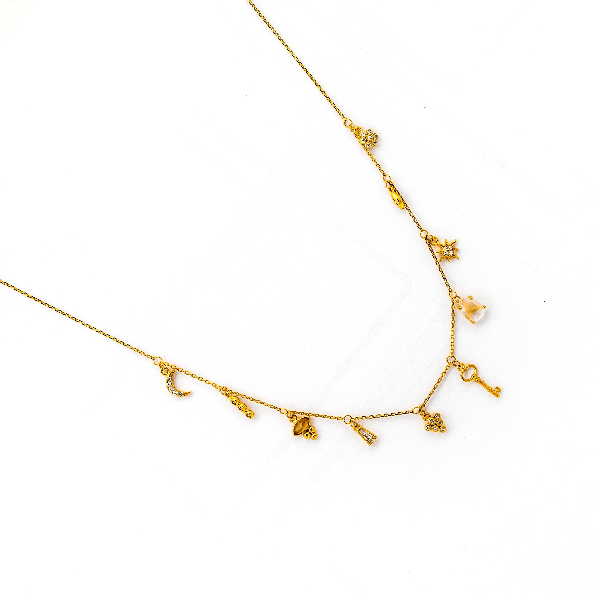 GOLD NECKLACE WITH STATIONED CHARMS