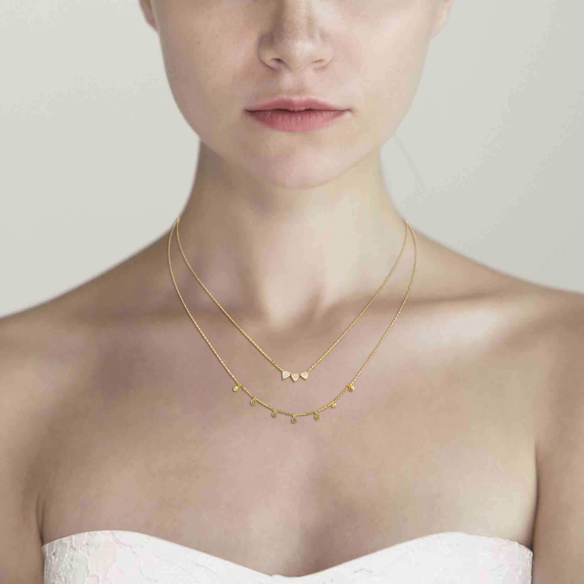 SIMPLE DOUBLE CHAIN NECKLACE WITH ROCK CRYSTAL CENTER AND STATIONED CZS