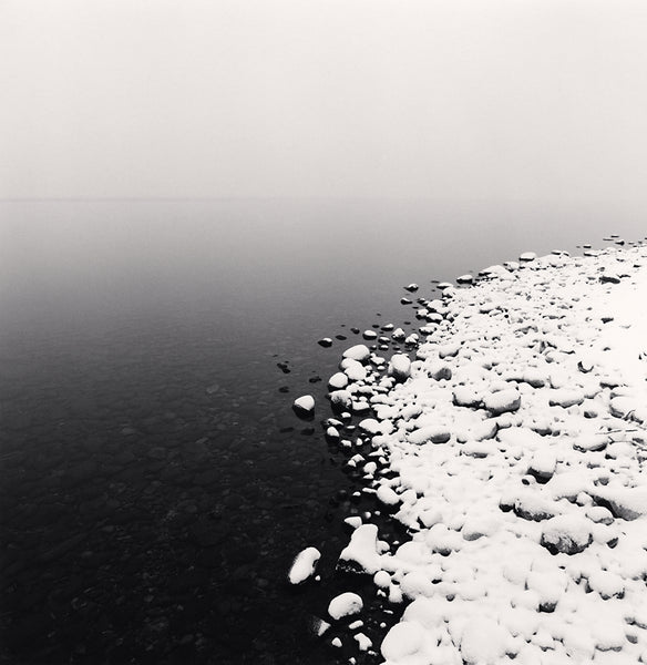 Michael Kenna - Snow on Pebbles, Toya Lake, Hokkaido, Sepia toned silver gelatin print, framed in grey with museum glass,  - Bau-Xi Gallery