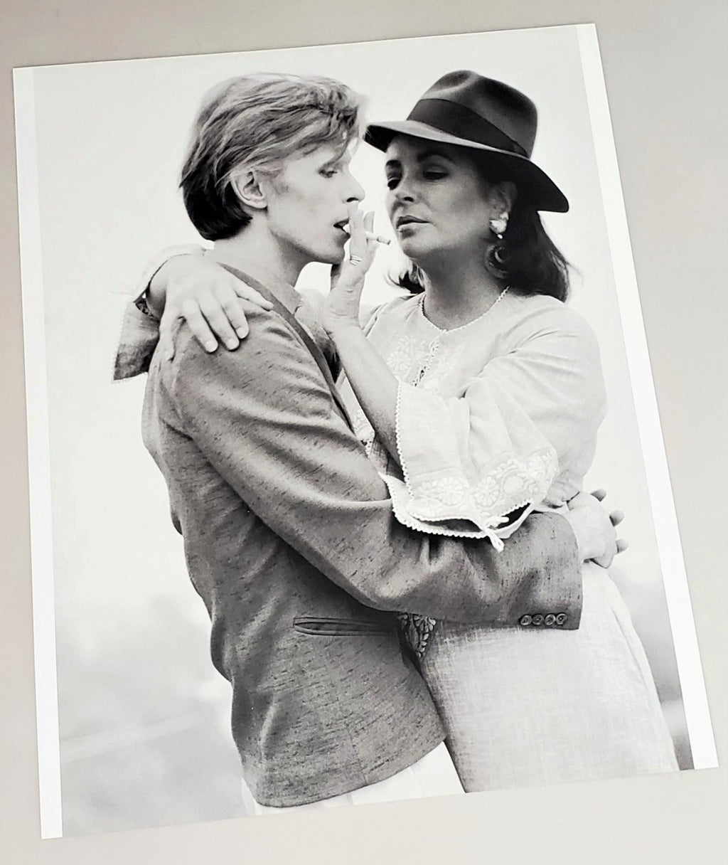 Photograph page of Bowie & Elizabeth Taylor in 1975 featured in 2010 David Bowie hardcover book by Jeff Hudson