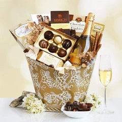 California Chandon Golden  Dazzle and delight someone very special with this sophisticated gift filled with Chandon sparkling wine and sweets. The beautiful holly embossed gold container will take their breath away and features a bottle of California Chandon sparkling wine.