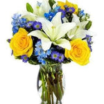 Blue Sky Flower Bouquet Same Day -Blue Sky  The gorgeous white Asiatic lilies grab your attention right away, but they only begin to tell the story of this uniquely beautiful bouquet also boasting yellow roses, blue delphinium and purple Monte Casino blooms.