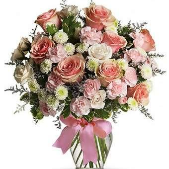 The Cotton Candy bouquet is the perfect arrangement to send to a special elderly person in your life. It includes beautiful light pink and white roses