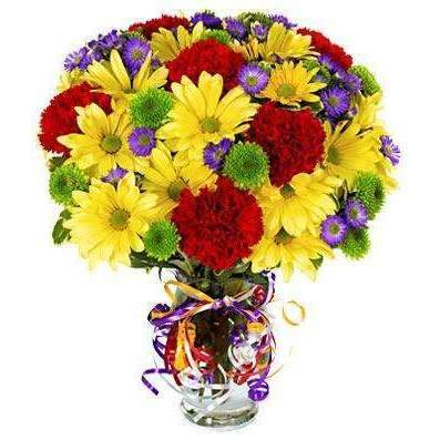Celebrate with a colorful flower bouquet! Arranged with fresh flowers including red carnations, yellow daisies, purple Monte Casino and green button poms.