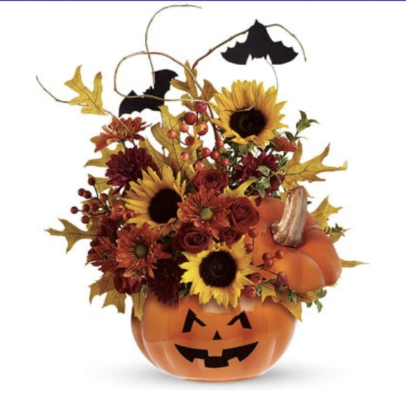 Jack-o-Lantern With Fall Flowers