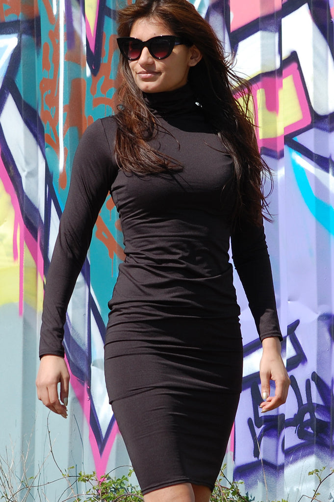 Kim K turtleneck dress black now online. Shop this Kim K turtleneck dress in a beautiful black color here online at Fashionjunks.com.