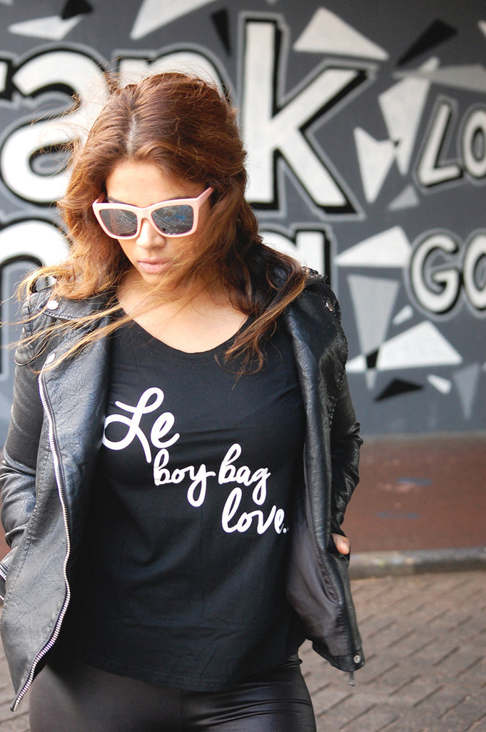 Shop this Boy bag T-shirt here! Freshen up your wardrobe with one of our fierce t-shirts! This shirt with the caption Le Boy Bag love is everything!
