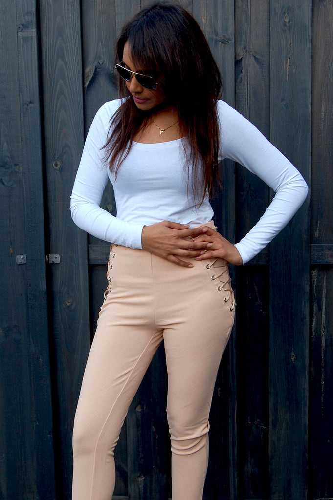 Lace up high waist pants. Shop this lace up high waist pants here in beige. Get a fresh look and step out in style in this high waisted trousers.