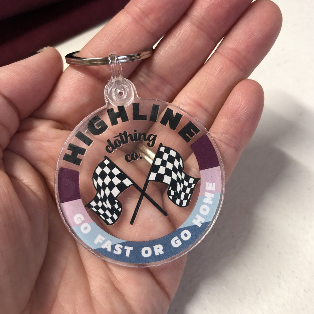 "Highline Clothing ""Go Fast or Go Home"" Clear Circle Keychain"