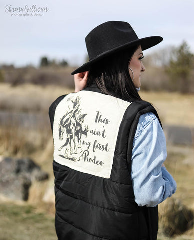 This Ain't My First Rodeo on Black Puff Vest - Saddles & Lace Boutique - Western and boho inspired clothing, bags, and accessories for women