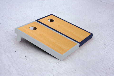 Custom cornhole boards with Navy and Gray borders with natural stained center
