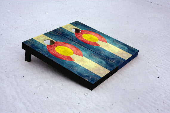 Custom Cornhole boards worn Colorado State Flag. Comes with 8 free bags.