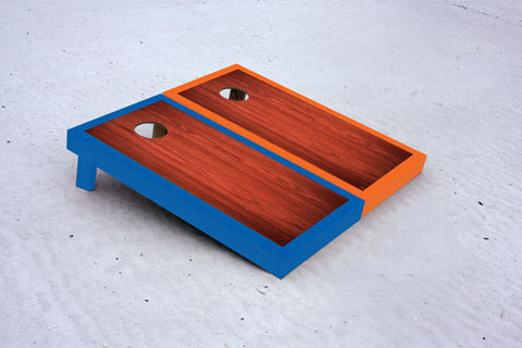 Custom cornhole boards with Blue and Orange borders with Rosewood stained center