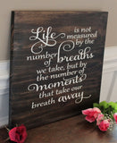 life is not measured by breaths wood sign